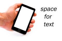 拿着移动电话的现有量巧妙 库存图片
