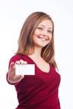 拿着空插件的微笑的妇女 免版税库存照片