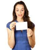 拿着空插件的美丽的妇女 免版税图库摄影