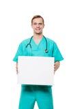 拿着空插件的微笑的医生被隔绝  图库摄影