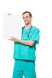 拿着空插件的微笑的医生被隔绝  库存图片