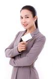 拿着空插件的愉快,微笑的女实业家 免版税图库摄影