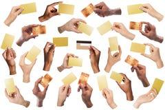 拿着空白的名片的不同的手拼贴画,被隔绝 免版税库存照片