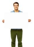 拿着空白的广告牌的人 免版税库存图片