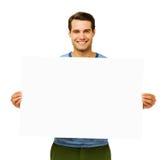 拿着空白的广告牌的确信的人 库存图片
