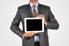 拿着空白的数字式片剂个人计算机,被隔绝的非常profe的商人 免版税库存图片