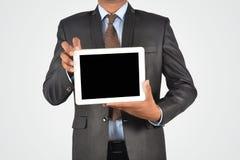 拿着空白的数字式片剂个人计算机,被隔绝的非常profe的商人 库存照片