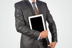 拿着空白的数字式片剂个人计算机,被隔绝的非常profe的商人 免版税库存照片