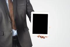 拿着空白的数字式片剂个人计算机,被隔绝的非常profe的商人 图库摄影