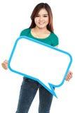 拿着空白的文本的微笑的女孩在specs起泡 免版税库存照片