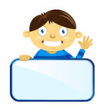 拿着空白的标志的男孩 免版税库存图片