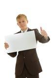 拿着空白的横幅的商人 免版税库存照片