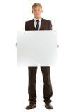 拿着空白的横幅的商人 图库摄影