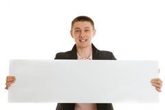 拿着空白的横幅的商人 库存照片