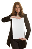 拿着空白的横幅的女实业家 库存照片