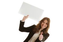 拿着空白的横幅的女实业家 图库摄影