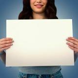 拿着空白的海报的妇女的综合图象 图库摄影
