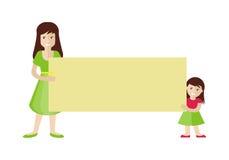 拿着空白的留言簿的妇女和女孩 图库摄影