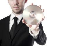 拿着空白的cd的人 库存图片