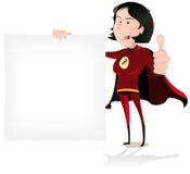 拿着空白符号的超级女孩英雄 免版税库存照片