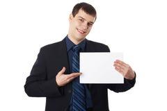 拿着空白董事会的新生意人 库存照片