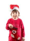 拿着空的圣诞节袜子的滑稽的小孩 图库摄影