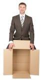 拿着空的箱子的商人 库存图片