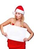 拿着空的董事会的圣诞老人帽子的妇女 免版税图库摄影