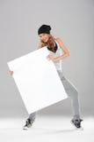 拿着空的董事会的新现代舞蹈演员 免版税图库摄影