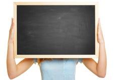 拿着空的黑板的妇女 免版税库存照片