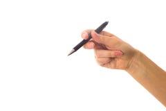 拿着笔的妇女的现有量 免版税库存图片