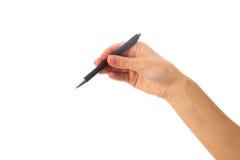 拿着笔的妇女的现有量 免版税库存照片