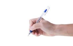 拿着笔的手 图库摄影