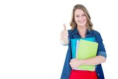拿着笔记本和文件的微笑的学生的综合图象 库存图片