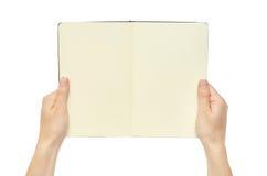 拿着笔记本的美好的女性手 背景查出的白色 库存图片