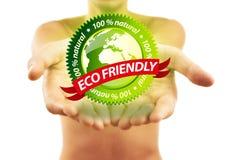 拿着符号的eco友好现有量 免版税库存照片