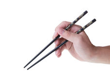 拿着筷子的人手 库存照片