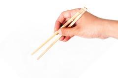拿着筷子 库存图片