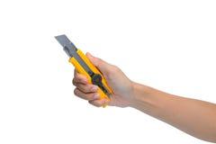 拿着箱子切削刀刀子的妇女手 库存照片