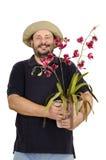 拿着红色兰花的卖花人 图库摄影