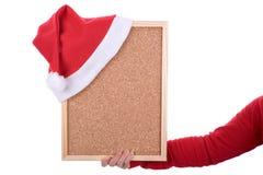 拿着红色圣诞老人的空的框架现有量帽子 免版税库存图片