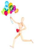 拿着红色心脏和气球的木钝汉 免版税库存照片
