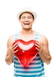 拿着红色心脏气球的拉丁美州的人 免版税库存图片