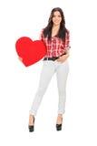 拿着红色心脏的可爱的女性 库存图片