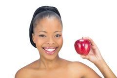 拿着红色苹果的可爱的妇女 免版税库存照片