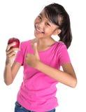 拿着红色苹果计算机VIII 免版税库存照片