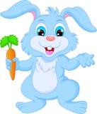 拿着红萝卜的动画片愉快的兔子 图库摄影