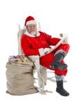 拿着纸卷的愉快的圣诞老人 免版税图库摄影