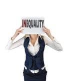 拿着纸片与词不平等的白女孩,在面孔水平 免版税库存照片