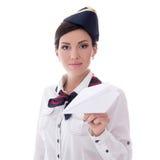 拿着纸飞机的年轻空中小姐被隔绝在白色 免版税库存照片